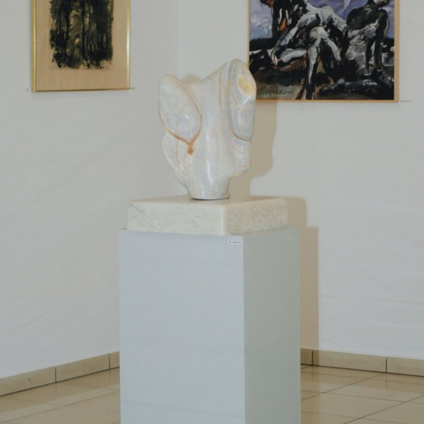 Abstract sculpture & paintings on display in the Minois Village Hotel Suites Art Gallery in Paros.