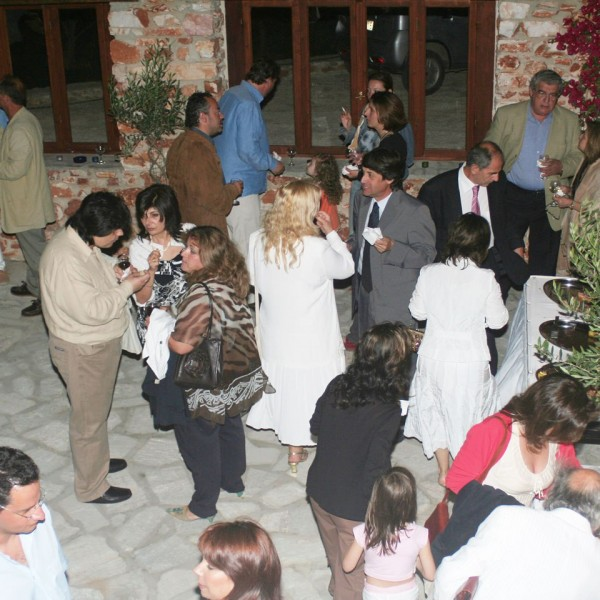 A crowd enjoys an exhibition event at the Minois Village Hotel Suites & Spa Art Gallery, Paros.