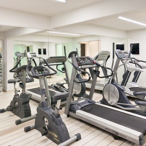 Treadmills and exercise bikes in the fully equipped gym of Minois Village Hotel Suites, Paros.