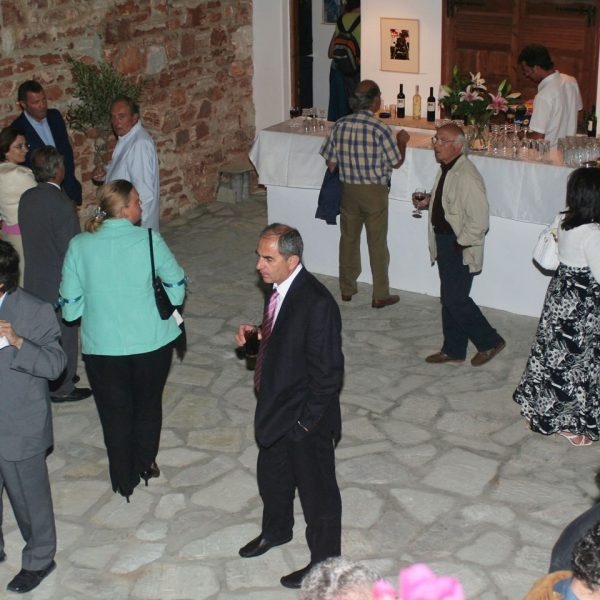People gather at an exhibition at the Art Gallery in Minois Village Hotel Suites & Spa, Paros