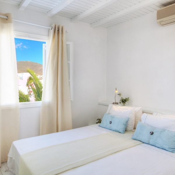 Double bed, open window, AC & herbs in Minois Village Grand Superior Ground Floor Sea View Suite