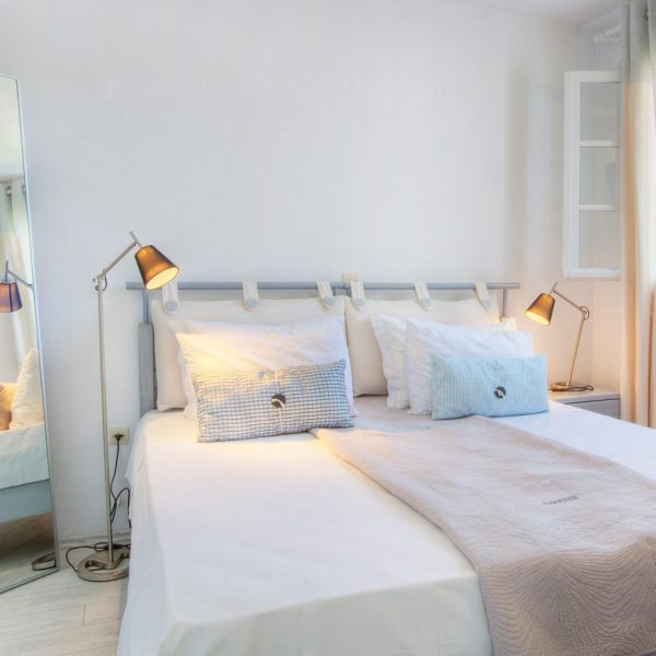 Lamps, window, mirror & double bed, Grand Superior Ground Floor Sea View Suite, Minois Village, Paros