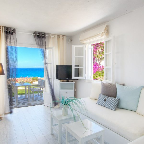 French doors, sofa, lamp, table, in Minois Village Grand Superior Ground Floor Sea View Suite, Paros