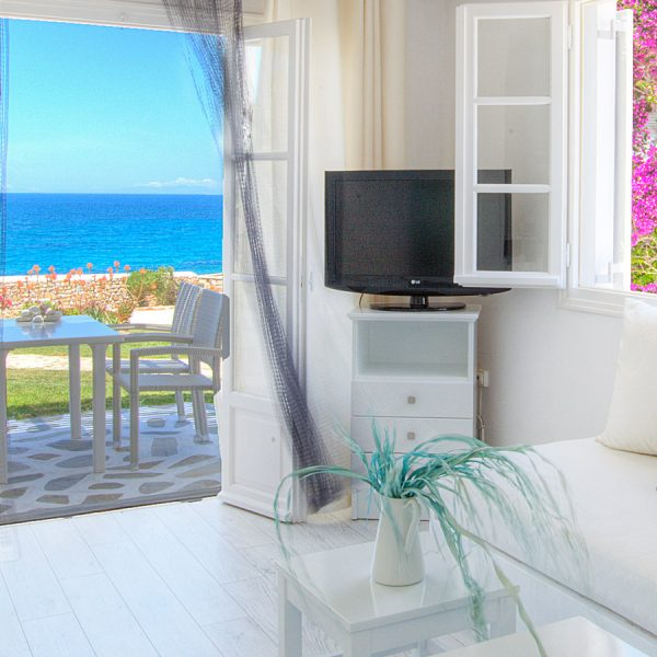 View of sea and veranda through french doors of Grand Superior Ground Floor Sea View Suite, Paros.