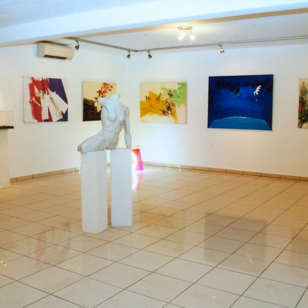 Modern sculpture & paintings displayed in Art Gallery area of Minois Village Hotel Suites, Paros.