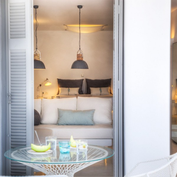 Looking through door to sofa & bed in Minois Village Superior Ground Floor Pool View Suite, Paros.